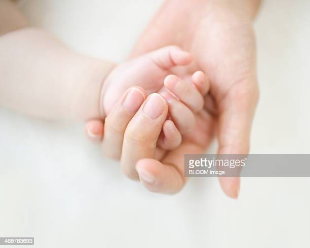 Baby's And Mother's Hand