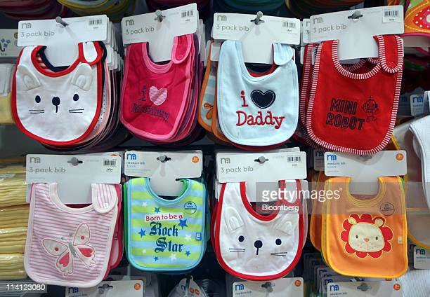 Baby's bibs sit on display at a Mothercare Plc store in London UK on Thursday May 12 2011 UK retail sales surged the most in five years last month as...