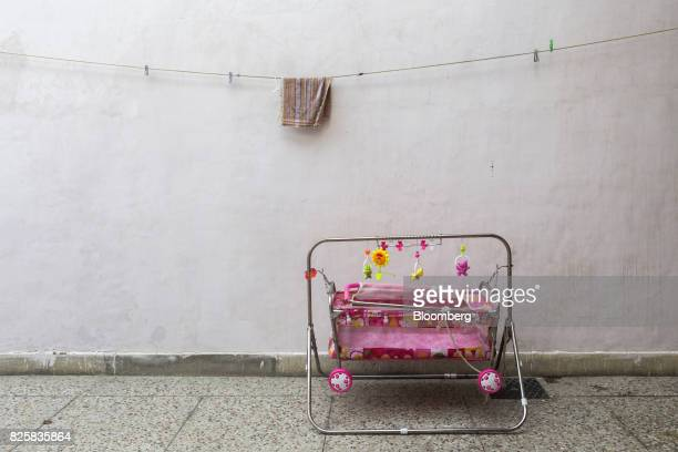 A baby's cot sits on the ground during a free doortodoor screening program conducted by Public Health Foundation of India and funded by Eli Lilly Co...