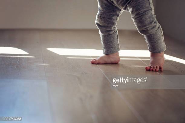 baby's feet - babyhood stock pictures, royalty-free photos & images