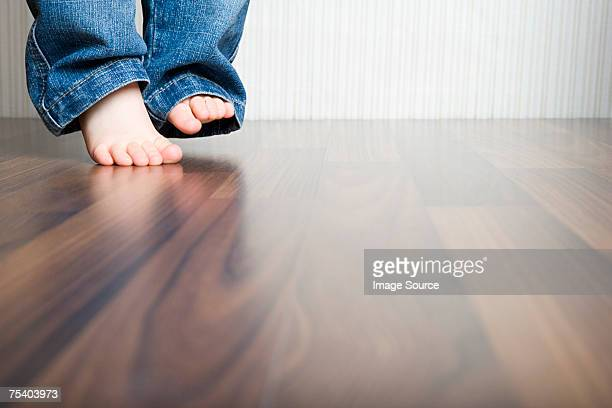babys feet - wooden floor stock pictures, royalty-free photos & images
