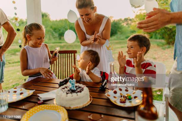 baby's first birthday party - happy birthday images for sister stock pictures, royalty-free photos & images