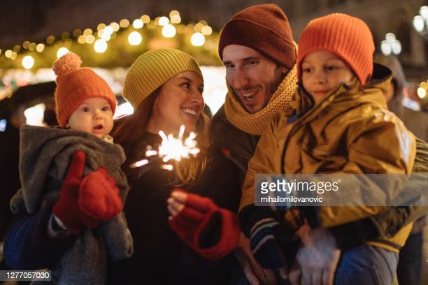 baby's first christmas - four people stock pictures, royalty-free photos & images