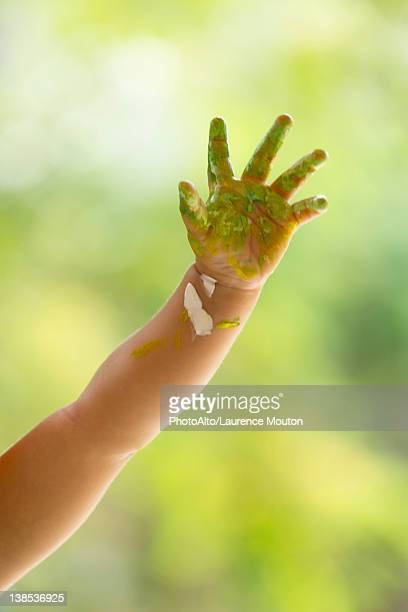 Baby's hand covered with paint