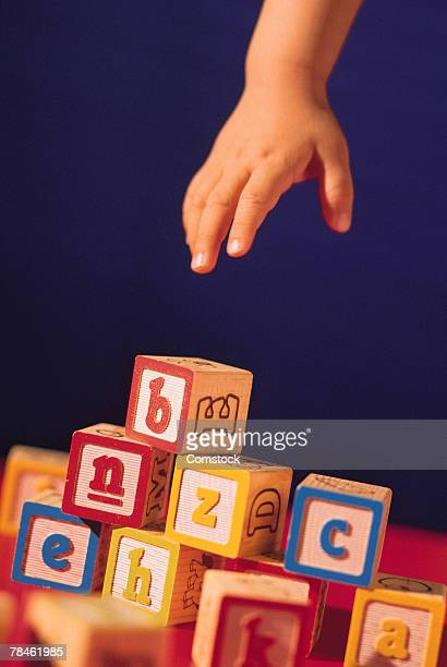 Baby's hand reaching for building blocks