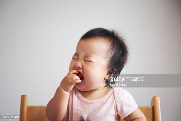 baby's surprised face just after she ate tomato for the first time in her life - sour taste stock pictures, royalty-free photos & images