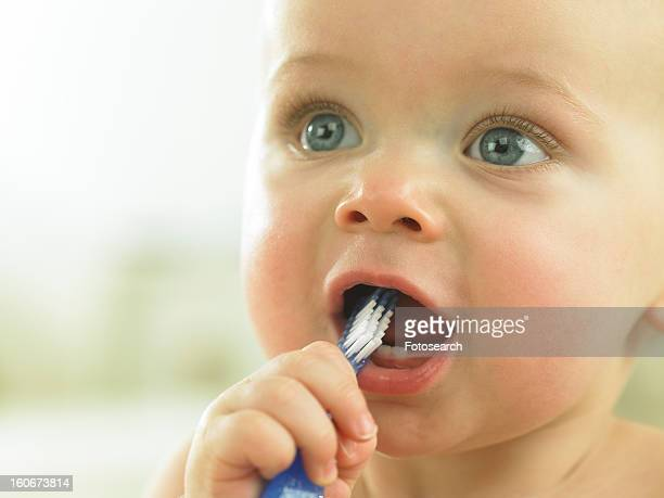 Baby's with toothbrush in mouth