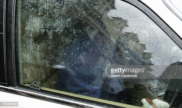 Babyshambles frontman Pete Doherty is seen driving away from court having written I love Kate 4 ever on the inside of his car window on March 9 2006...