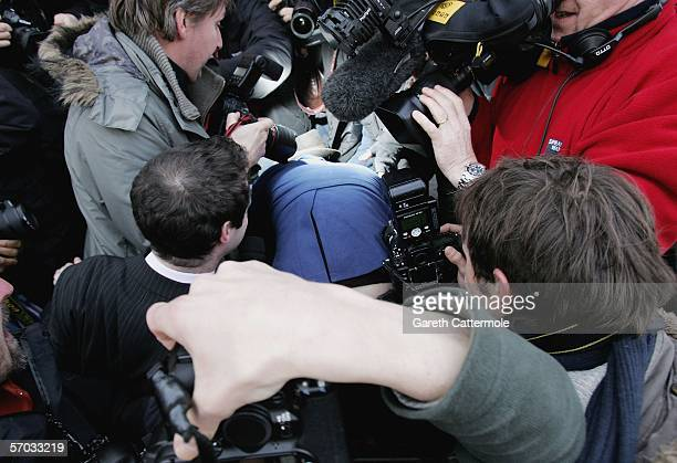 Babyshambles frontman Pete Doherty struggles through photographers to make his way to court on March 9 2006 Pete is appearing on bail charged with...