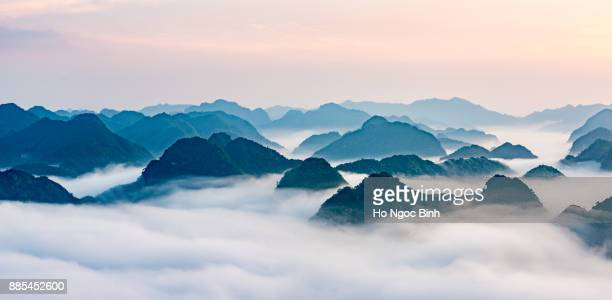 bac son valey. lang son, viet nam - mountain peak above clouds - asian style conical hat stock pictures, royalty-free photos & images