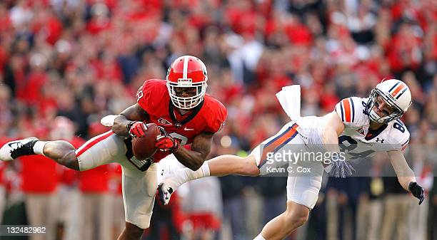 Bacarri Rambo of the Georgia Bulldogs intercepts a pass intended for Dimitri Reese of the Auburn Tigers and returns it for a touchdown at Sanford...
