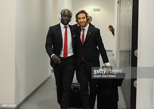 Bacary Sagna and Mathieu Flamini walk into the Arsenal changing room before the Barclays Premier League match between Arsenal and West Bromwich...