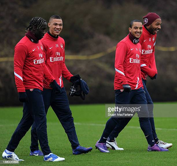 Bacary Sagna Kieran Gibbs Theo Walcott and Thierry Henry of Arsenal during a training session at London Colney on January 31 2012 in St Albans England