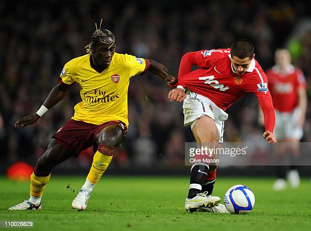 Bacary Sagna of Arsenal and Javier Hernandez of Manchester United battle for the ball during the FA Cup sponsored by E.On Sixth Round match between...