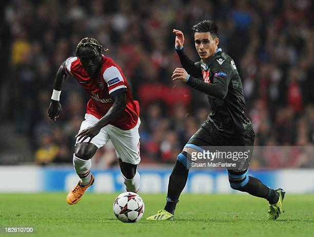 Bacary Sagna of Arsenal breaks past Jose Callejon of Napoli during the UEFA Champions League Group F match between Arsenal FC and SSC Napoli at...