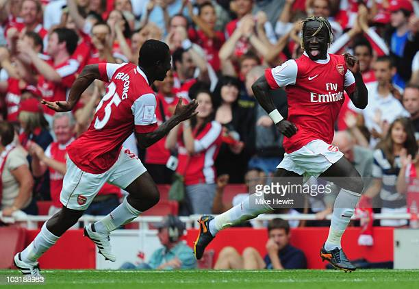 Bacary Sagna of Arsenal celebrates after scoring with team mate Emmanuel Frimpong during the Emirates Cup match between Arsenal and Celtic at...