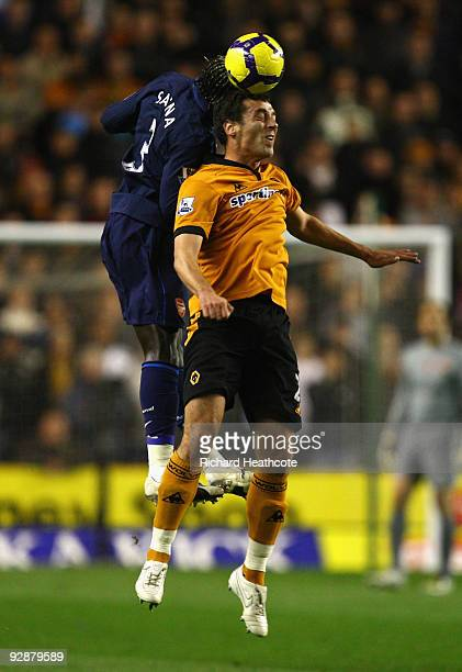 Bacary Sagna of Arsenal goes up for a header with Nenad Milijas of Wolverhampton Wanderers during the Barclays Premier League match between...