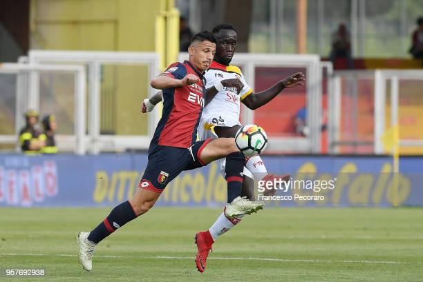 Bacary Sagna of Benevento Calcio vies with Gianluca Lapadula of Genoa CFC during the serie A match between Benevento Calcio and Genoa CFC at Stadio...