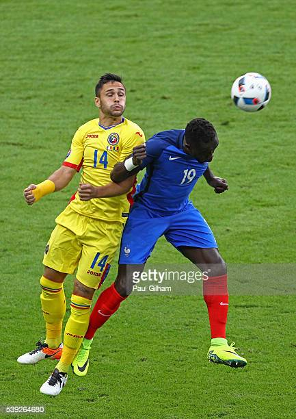 Bacary Sagna of France and Florin Andone of Romania compete for the ball during the UEFA Euro 2016 Group A match between France and Romania at Stade...