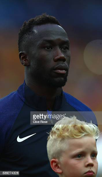 Bacary Sagna of France lines up for the national anthem prior to the UEFA Euro 2016 Group A match between France and Romania at Stade de France on...