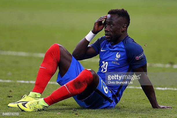 Bacary Sagna of France looks dejected at fulltime following the UEFA Euro 2016 Final match between Portugal and France at Stade de France on July 10...