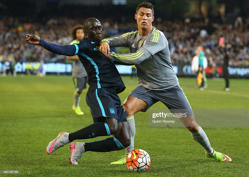 Bacary Sagna of Manchester City and Cristiano Ronaldo of Real Madrid compete for the ball during the International Champions Cup match between Real Madrid and Manchester City at Melbourne Cricket Ground on July 24, 2015 in Melbourne, Australia.