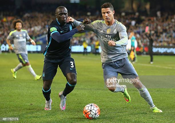 Bacary Sagna of Manchester City and Cristiano Ronaldo of Real Madrid compete for the ball during the International Champions Cup match between Real...