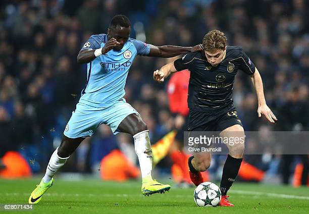 Bacary Sagna of Manchester City and James Forrest of Celtic battle for possession during the UEFA Champions League Group C match between Manchester...