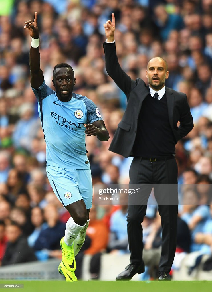 Bacary Sagna of Manchester City and Josep Guardiola, Manager of Manchester City appeal for a decision during the Premier League match between Manchester City and Sunderland at Etihad Stadium on August 13, 2016 in Manchester, England.