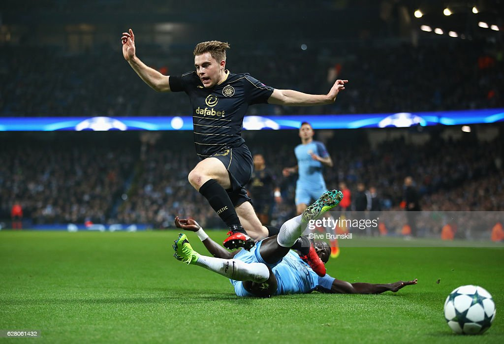 Bacary Sagna of Manchester City tackles James Forrest of Celtic during the UEFA Champions League Group C match between Manchester City FC and Celtic FC at Etihad Stadium on December 6, 2016 in Manchester, England.