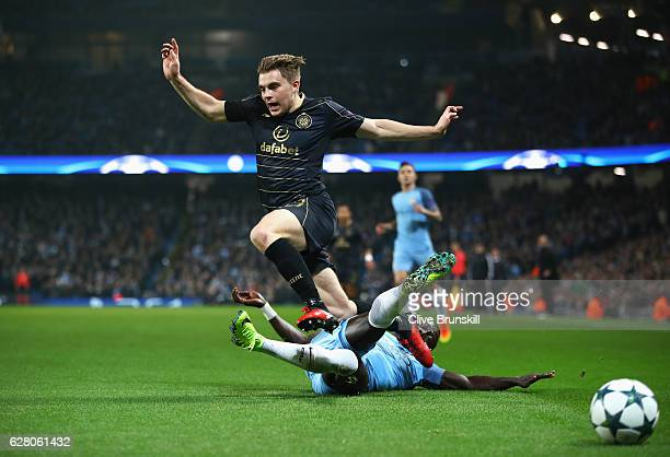 Bacary Sagna of Manchester City tackles James Forrest of Celtic during the UEFA Champions League Group C match between Manchester City FC and Celtic...