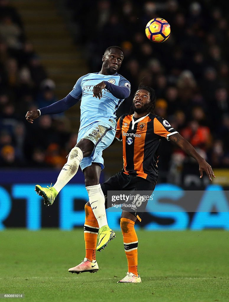 Bacary Sagna of Manchester City wins a header with Dieumerci Mbokani of Hull City during the Premier League match between Hull City and Manchester City at KCOM Stadium on December 26, 2016 in Hull, England.