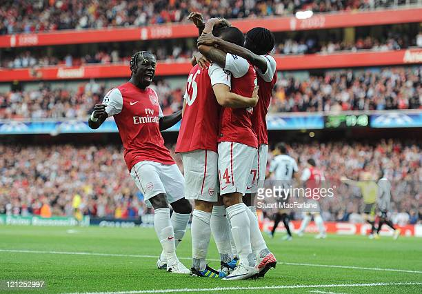 Bacary Sagna Theo Walcott Aaron Ramsey and Gervinho of Arsenal celebrate with goalscorer Theo Walcott during the UEFA Champions League PlayOff First...