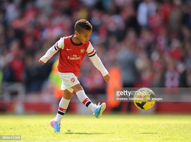 Bacary Sagna's son Elias Sagna kicks a ball on the pitch after the final whistle