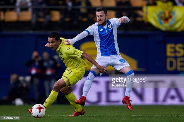 Bacca of Villarreal CF competes for the ball with Tito of CD Leganes during the Copa del Rey Round of 16 second leg game between Villarreal CF and CD...