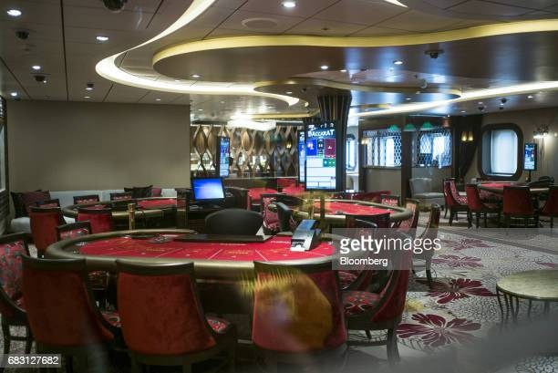 Baccarat tables stand inside a casino on board the Ovation of the Seas Quantumclass cruise ship operated by Royal Caribbean Cruises Ltd at the Kai...