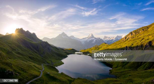 bachalpsee lake at dawn, bernese oberland, switzerland - switzerland stock pictures, royalty-free photos & images