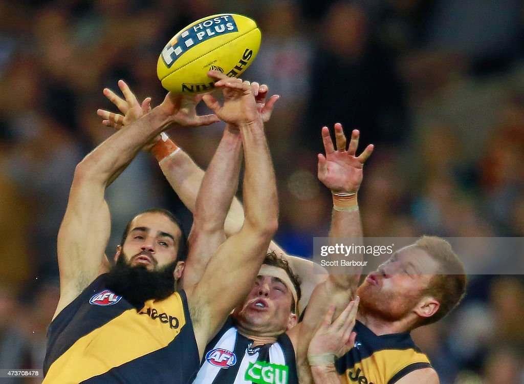 Bachar Houli (L) and Nick Vlastuin of the Tigers and Jarryd Blair (C) of the Magpies compete for the ball during the round seven AFL match between the Richmond Tigers and the Collingwood Magpies at the Melbourne Cricket Ground on May 17, 2015 in Melbourne, Australia.