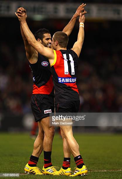 Bachar Houli of the Bombers celebrates a goal with David Zaharakis during the round 18 AFL match between the Essendon Bombers and St Kilda Saints at...