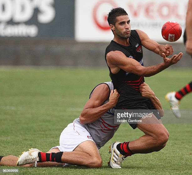 Bachar Houli of the Bombers handballs during an Essendon Bombers intraclub AFL match at Deakin Oval on February 3 2010 in Shepparton Australia