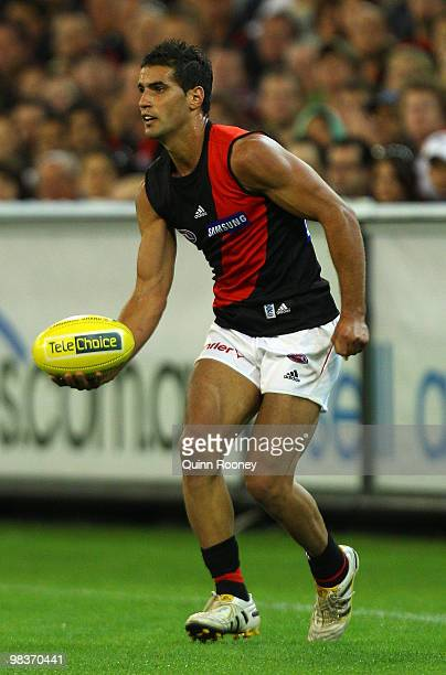 Bachar Houli of the Bombers handballs during the round three AFL match between the Carlton Blues and the Essendon Bombers at the Melbourne Cricket...