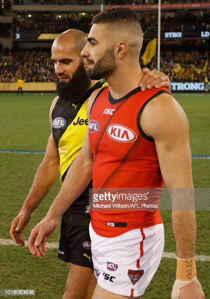 Bachar Houli of the Tigers and Adam Saad of the Bombers look on during the 2018 AFL round 22 match between the Richmond Tigers and the Essendon...
