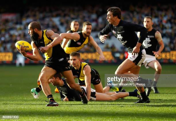 Bachar Houli of the Tigers and Caleb Marchbank of the Blues in action during the 2017 AFL round 14 match between the Richmond Tigers and the Carlton...