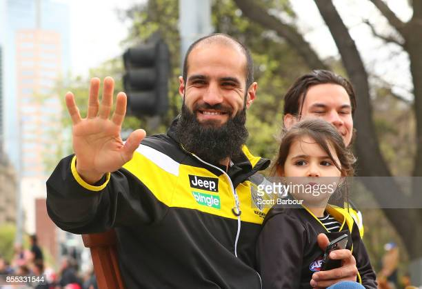 Bachar Houli of the Tigers and Daniel Rioli of the Tigers wave to the crowd during the 2017 AFL Grand Final Parade ahead of the Grand Final between...