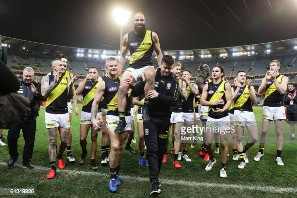 Bachar Houli of the Tigers celebrates victory with team mates after the round 19 AFL match between the Collingwood Magpies and the Richmond Tigers at...