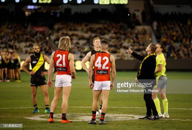 Bachar Houli of the Tigers Dyson Heppell of the Bombers Jack Riewoldt of the Tigers and Adam Saad of the Bombers watch as the coin is tossed during...