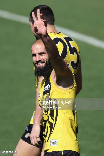 Bachar Houli of the Tigers gestures to kids from his Bachar Houli Academy during a Richmond Tigers AFL training session at Punt Road Oval on...