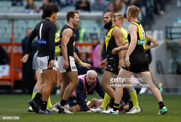 Bachar Houli of the Tigers remonstrates with Blues players as Jed Lamb of the Blues lays injured during the 2017 AFL round 14 match between the...