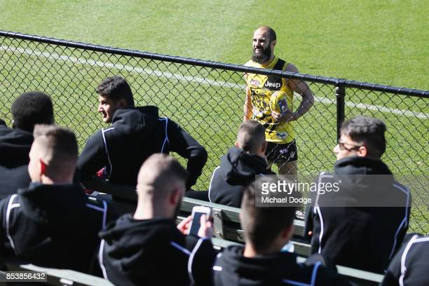 Bachar Houli of the Tigers speak to kids from his Bachar Houli Academy during a Richmond Tigers AFL training session at Punt Road Oval on September...