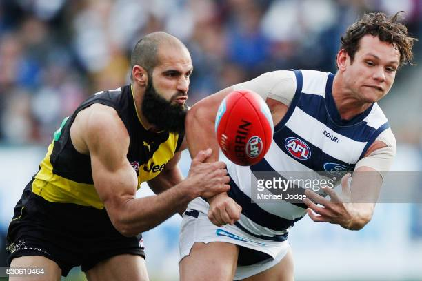 Bachar Houli of the Tigers tackles Steven Motlop of the Cats during the round 21 AFL match between the Geelong Cats and the Richmond Tigers at...